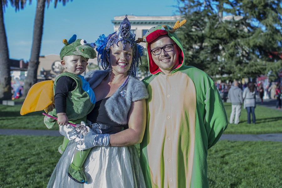 The Dragon Family, little Caelen, Fairy Princess Lael, and Poppa Dragon Gil, enjoy the plaza atmosphere. - ALEXANDER WOODARD