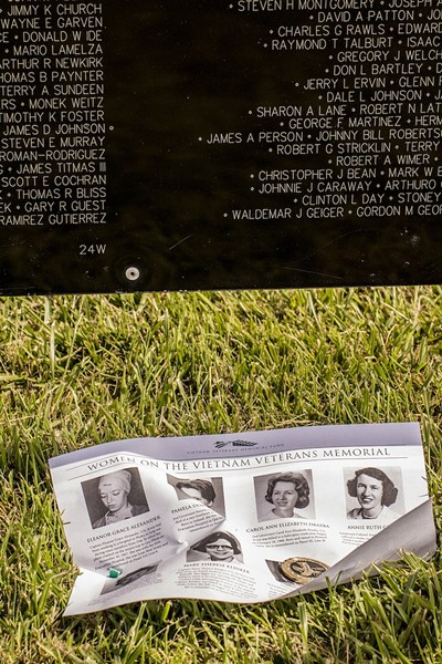 "Navy veteran Spencer T. ""Ernie"" Earnshaw, 71, of Loleta, said he found this token dedicated to the women who volunteered to go to Vietnam, and decided to place it at the Wall memorial with a handout with photos and descriptions of the eight women whose names are on the Wall.  He placed both just under the name of Sharon Ann Lane who was killed in 1969. The token reads, ""Tribute to women veterans,"" ""She chose to serve"" - MARK LARSON"
