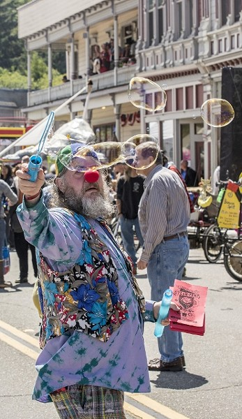 Zeke Diroberto (a.k.a. Zig Zag the Clown), a Kinetic Peon from McKinleyville, provides bubbles in Ferndale in 2014. - MARK LARSON