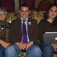 Newly elected city council member Shane Brinton cozies up next to his Mom, Susan Brinton (left), and Kaitlin Sopoci-Belknap to watch election results trickle in.