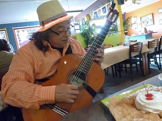 Nicaragua-born guitarist Angel Fargas plays for diners at Carmela's Mexican Restaurant in McKinleyville every Friday evening. - PHOTO BY BOB DORAN