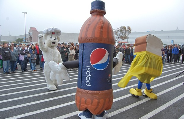 No one's happier about the new wal-mart than bimbo bear, this walking pepsi bottle and ... is that bread wearing a skirt? - PHOTO BY ANDREW GOFF