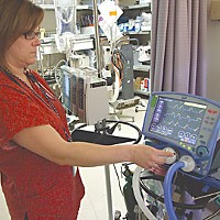 Mending Broken Hearts Nurse Jenny Tehan is part of a successful effort in the intensive care unit to wipe out ventilator associated pneumonia.  After recording 20 in 2006, St. Joseph Hospital has had none in the last 25 months. Photo by Carol Harrison