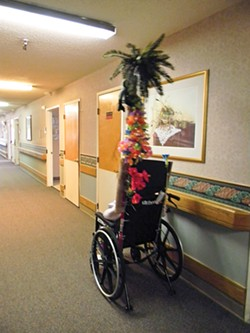 PHOTO BY CARRIE PEYTON DAHLBERG - Nurses and aides have decorated the poles attached to some wheelchairs at Seaview Rehabilitation & Wellness Center. The poles are utilitarian – they cannot get past shower rods put over the doors of people who don't want confused neighbors wandering into