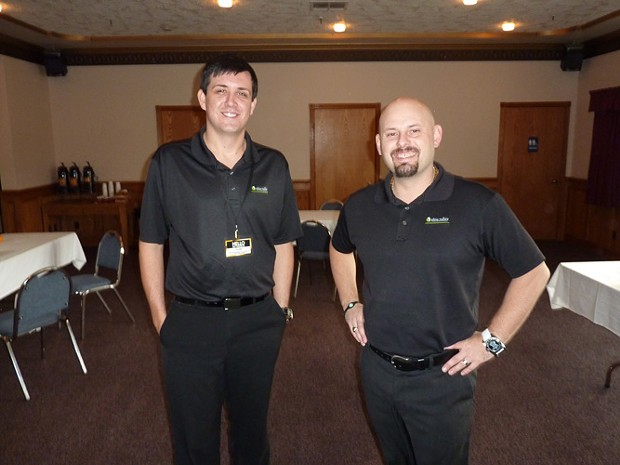 Ohio Valley Gold and Silver Refinery's Dustin Barton (left) and Nate Shaffer set up with most of their gear at the Best Western Bayshore Inn. - PHOTO BY HANK SIMS