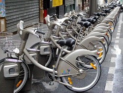 """One of hundreds of """"Vélib"""" bicycle rental stands in Paris operated by the Paris Mairie (City Hall). The three-speed unisex bikes rent for one euro (about $1.25) a day for an unlimited number of 30-minute trips. Longer journeys cost more."""