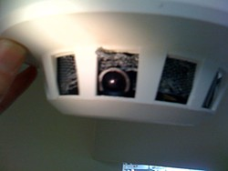 One of the spy cameras disguised to look like a smoke detector.
