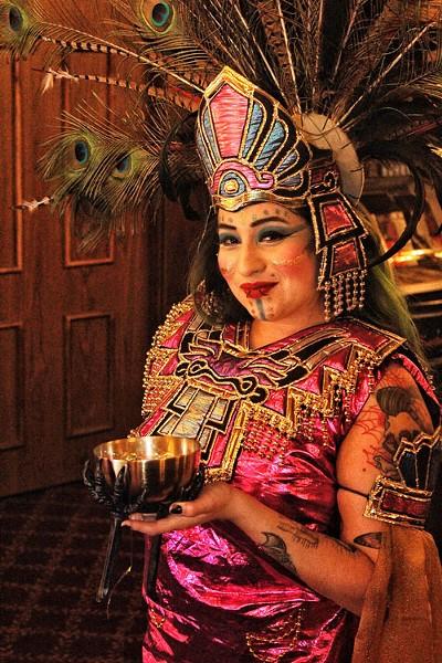Ophelia Cox, an Inca dancer from Va Va Voom, prepares backstage on March 28 at the Eureka Inn's Palm Lounge. - PHOTOS BY BOB DORAN