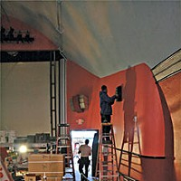 Tale of Two Theaters Painter painting the Arcata Theater Lounge. Photo by Bob Doran