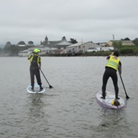 Patricia Cheng Terry paddles with Tim Haywood.