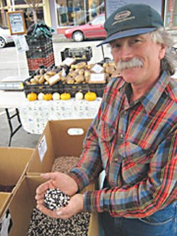Paul Giuntoli brags on his beans at Arcata's Farmers' Market. Photo by Bob Doran.