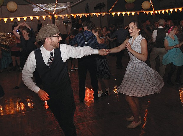 Phillip Nicklas & Alana McConnell swinging the Lindy Hop at Dance of the Centuryon April 25, with hip hop by Humboldt Rockers and music from all eras spun by Pressure Anya in the HSU's Lumberjack Arena. - PHOTO BY BOB DORAN