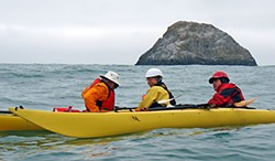 Pilot Rock is the backdrop as Explore North Coast kayak club members David Moore, Larry Buwalda and Mark Lufkin practice rescue techniques near Trinidad. Photo by the Author