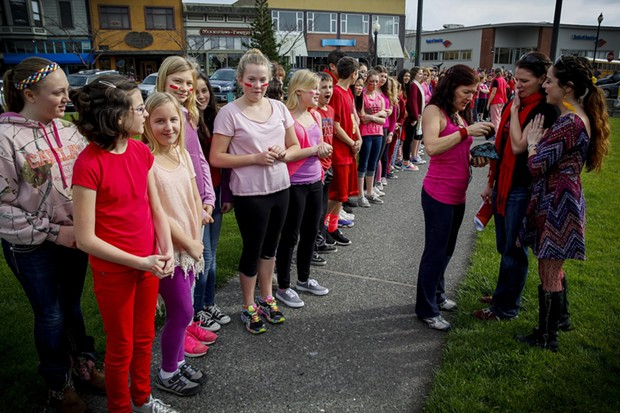 One-hundred-and-twenty students from Sunny Brae Middle School performed at the Arcata Plaza as part of V-Day, a worldwide movement to eliminate violence toward women and girls. - MANUEL J. ORBEGOZO