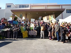 PHOTO BY RYAN BURNS - Protesters pose for a group shot outside of Caltrans' Eureka offices.
