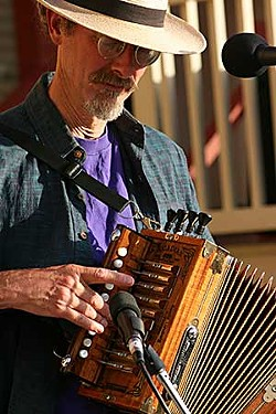 Randle Lundberg plays button accordion with The Bayou Swamis at last year's Humboldt Folklife Festival.  Photo by Bob Doran