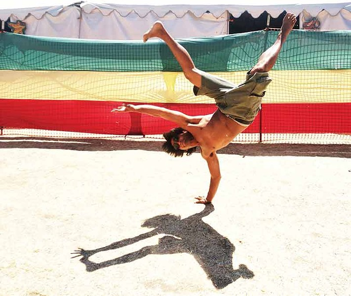 Reckless Rex Atlenza, leader of the break dance crew Humboldt Rockers, breaks a move backstage at Reggae on the River Sunday afternoon, Aug. 3. - PHOTO BY BOB DORAN