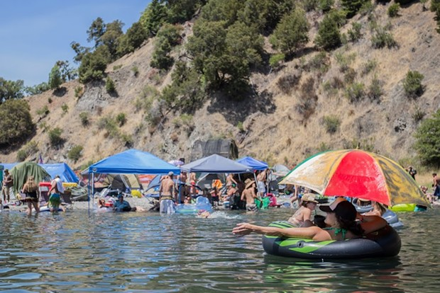 ROTR attendees keep cool in the Eel River as air temperatures reach 106 degrees. - ALEXANDER WOODARD