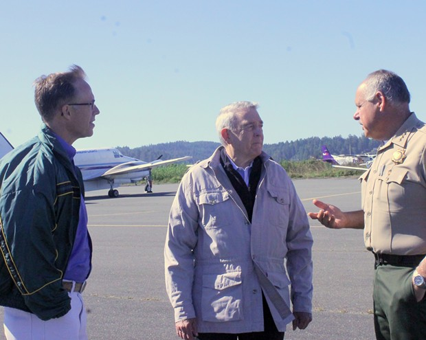 Rep. Huffman (left), news legend Dan Rather and Humboldt County Sheriff Mike Downey chat on the tarmac. - IMAGE COURTESY REP. HUFFMAN'S OFFICE
