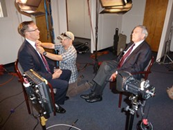 PHOTO BY RYAN BURNS - Rep. Jared Huffman (left) gets primped for his interview with Dan Rather.