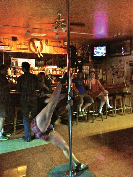 Rhonda rocks the pole at the Branding Iron. - PHOTO BY ANDREW GOFF