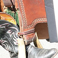Roger Rodoni, Roger's boots take a final ride in Saturday's Rhododendron Parade. Photo by Bob Doran.