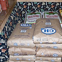 Survival! Sacks of dry goods rub shoulders with cans and spices in Robinson's storeroom. Photo by Kym Kemp.