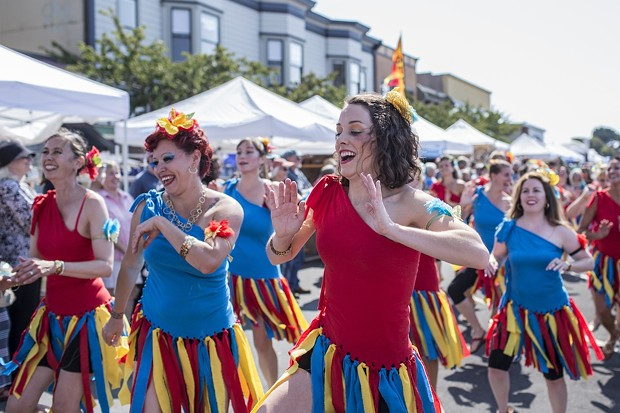 Samba dancers parade around the Arcata Plaza on Saturday. - ALEXANDER WOODARD