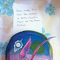 Saving Sam Sam's friend, Chrisse Harnos, brought to the memorial this artwork that Sam created in a class at the Emma Center. Photo by Heidi Walters