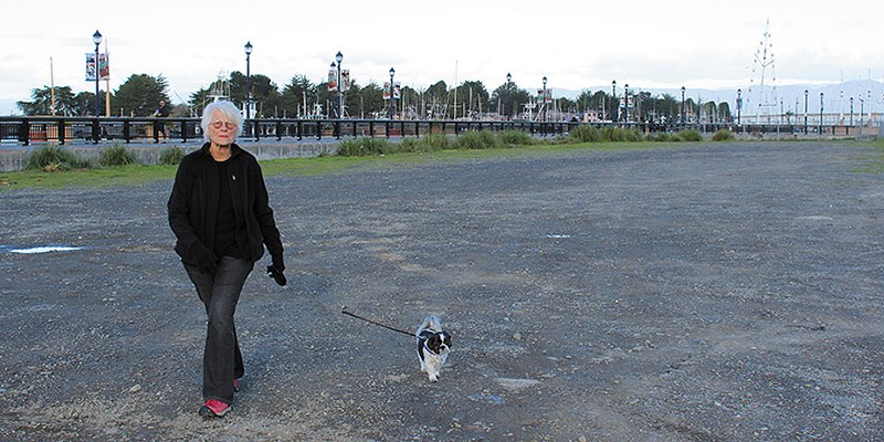 Conflicting Reports Sandra Lingle, a 32-year Eureka resident, has taken to walking her dog, Lou, only during daylight hours because she feels crime has gotten out of hand in the city. Photo by Thadeus Greenson