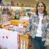 Mall Town Sandy Powell opened her baby boutique in the mall because she said it's where most people in town go to shop. She gets lots of out-of-town shoppers, too. Photo by Heidi Walters