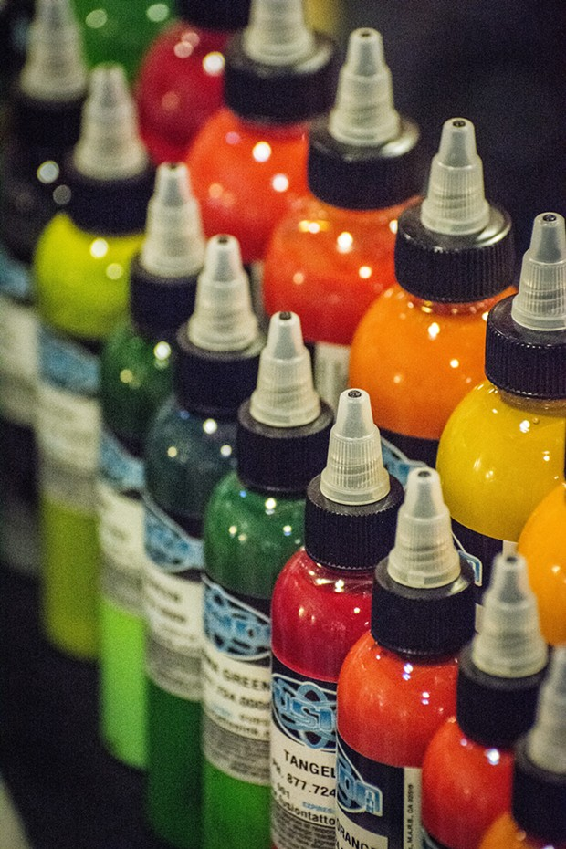 """Several booths offered original art, standard """"flash"""" and other products, such as ink, at the Expo. - MARK LARSON"""