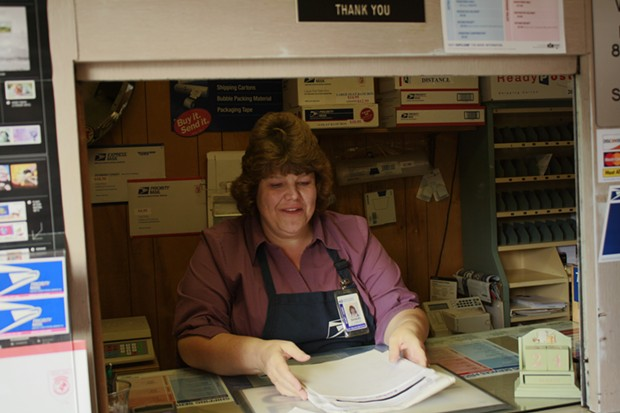 Shari Creps has been working at the Korbel post office for 13 years. It's the last remnant of a formerly booming town, she said. - ZACH ST. GEORGE