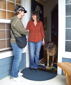 PHOTO BY HEIDI WALTERS - Sharon Latour, knocking on doors, encountered supporter Brenda Pease and dog Suzie.