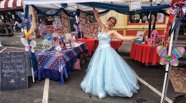 Shoshanna of Redwood Raks CASTS free pixie dust spells in her booth at the Arcata Chamber of Commerce's Fourth of July Jubilee celebration on the plaza. - PHOTO BY BOB DORAN