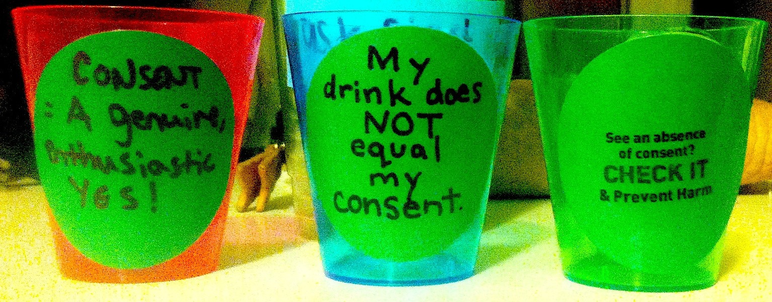 Shot glasses displaying pro-consent slogans. - CHECK IT'S FACEBOOK PAGE