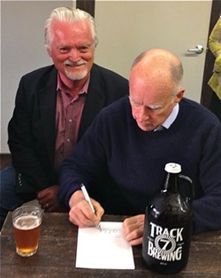 Assemblymember Wesley Chesbro grinnin' like a fool at Track Seven Brewing Co. in Sacramento while Gov. Jerry Brown signs his growler bill, AB 647. - PHOTO COURTESY WES CHESBRO'S OFFICE