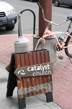 PHOTO BY BOB DORAN - Signs announce a Catalyst Church meeting at Humbrews.