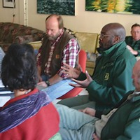 Klamath: Direct Action! Six Rivers National Forest Supervisor Tyrone Kelley talks with Orleans community members at a December 2007 collaborative meeting. Photo by Malcolm Terence.