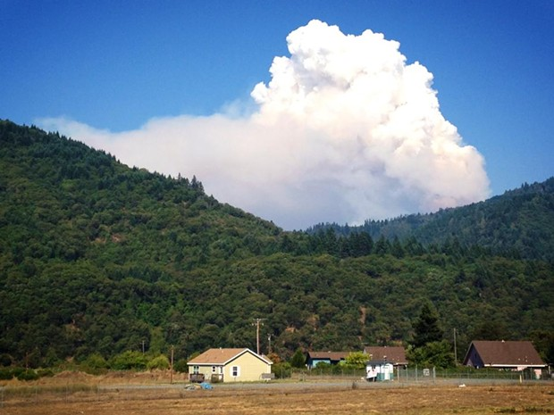 Smoke rises over the Hoopa Valley Tribal Reservation. - KEN MALCOMSON