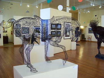 Elizabeth Berrien's horse bows its head in the gallery. - JENNIFER FUMIKO CAHILL