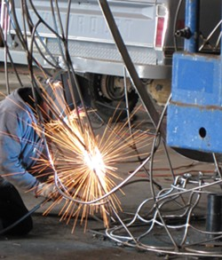 PHOTO BY JASON MARAK - Sparks fly - Jack Sewell at work