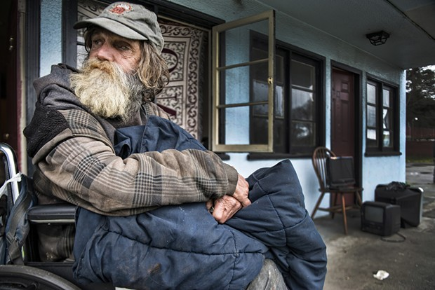 Guy Anderson, pictured here on the day the city of Eureka shuttered the Blue Heron Lodge, is one of seven tenants who filed a claim for damages against the city, arguing it had violated his civil rights. Anderson, who was moved into transitional housing, had lived at the Heron for six months. - MARK MCKENNA