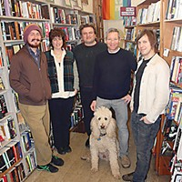 Flash Fiction Winners Staff of Northtown Books: (l-r) Erik Syverson, Monica Zerzan, Jay Herzog, Dante Digenova, Deric Mendes, Max (in front), photo by Bob Doran