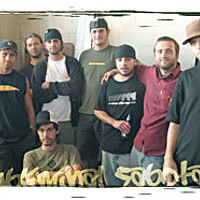 "Humboldt Hip Hop Subliminal Sabotage with B. Swizlo (far left) and Piet ""Demolition"" Dalmolen, (fifth from left). Photo by Bob Doran."