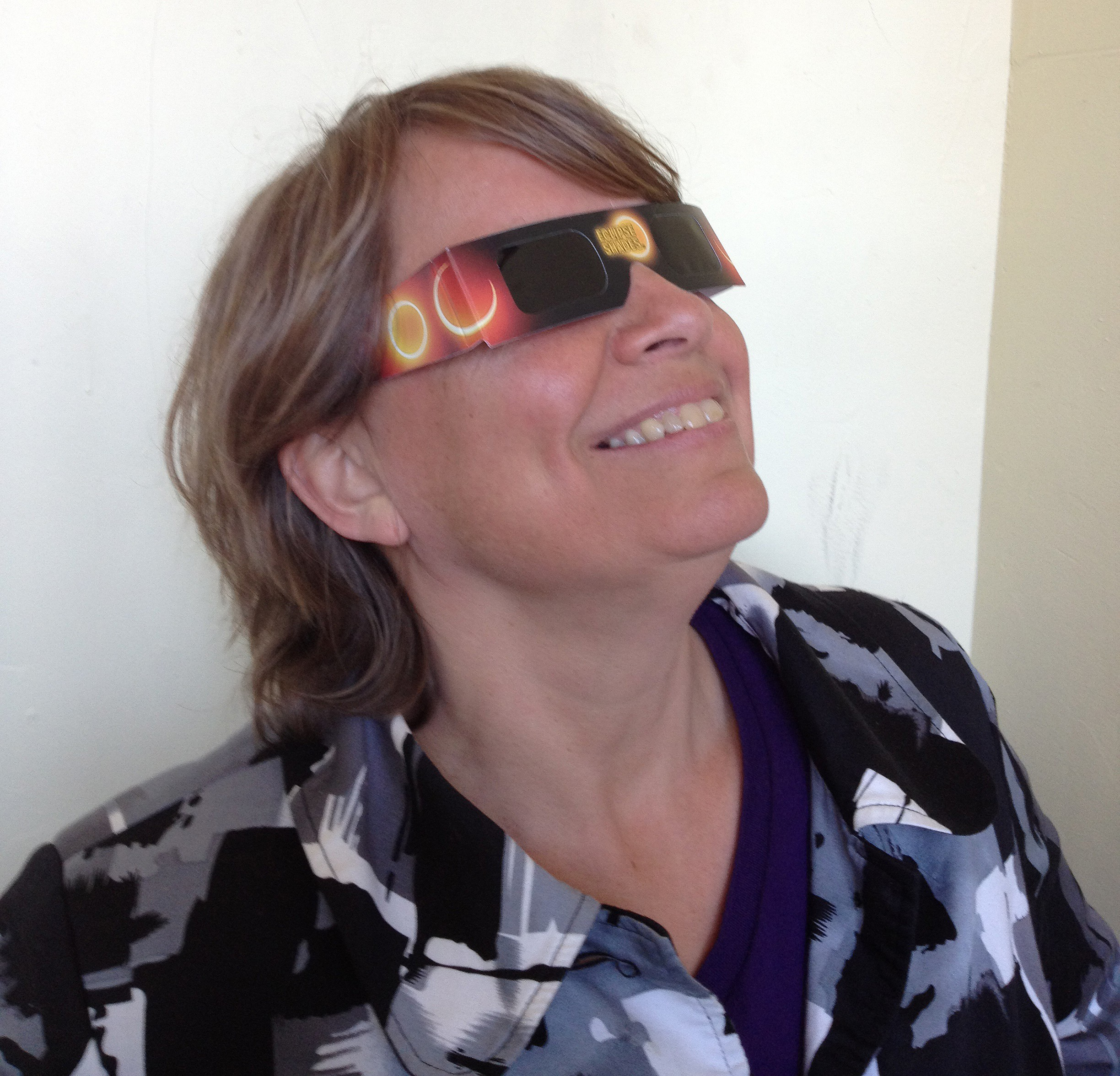 The Arcata Playhouse's Jackie Dandeneau wearing special eclipse viewing glasses - PHOTO BY BOB DORAN