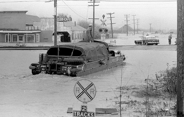 "The Army Reserve used DUKWs, or ""Ducks,"" to rescue people stranded on rooftops and boat them to safety. - PHOTO COURTESY OF GREG RUMNEY"