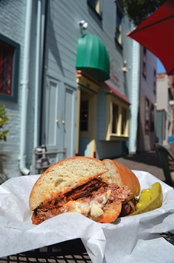 The Blue Noon burger, al fresco, at Café Nooner. - PHOTO BY JENNIFER FUMIKO CAHILL