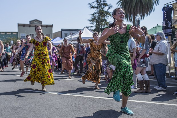 The first dancers of the parade make their way down Ninth Street at the North County Fair. - ALEXANDER WOODARD