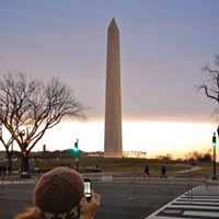 Thronging to the Inaugural The glorious morning sky (seen here behind the Washington Monument) made us forget our frozen digits. Photo by Andrew Goff
